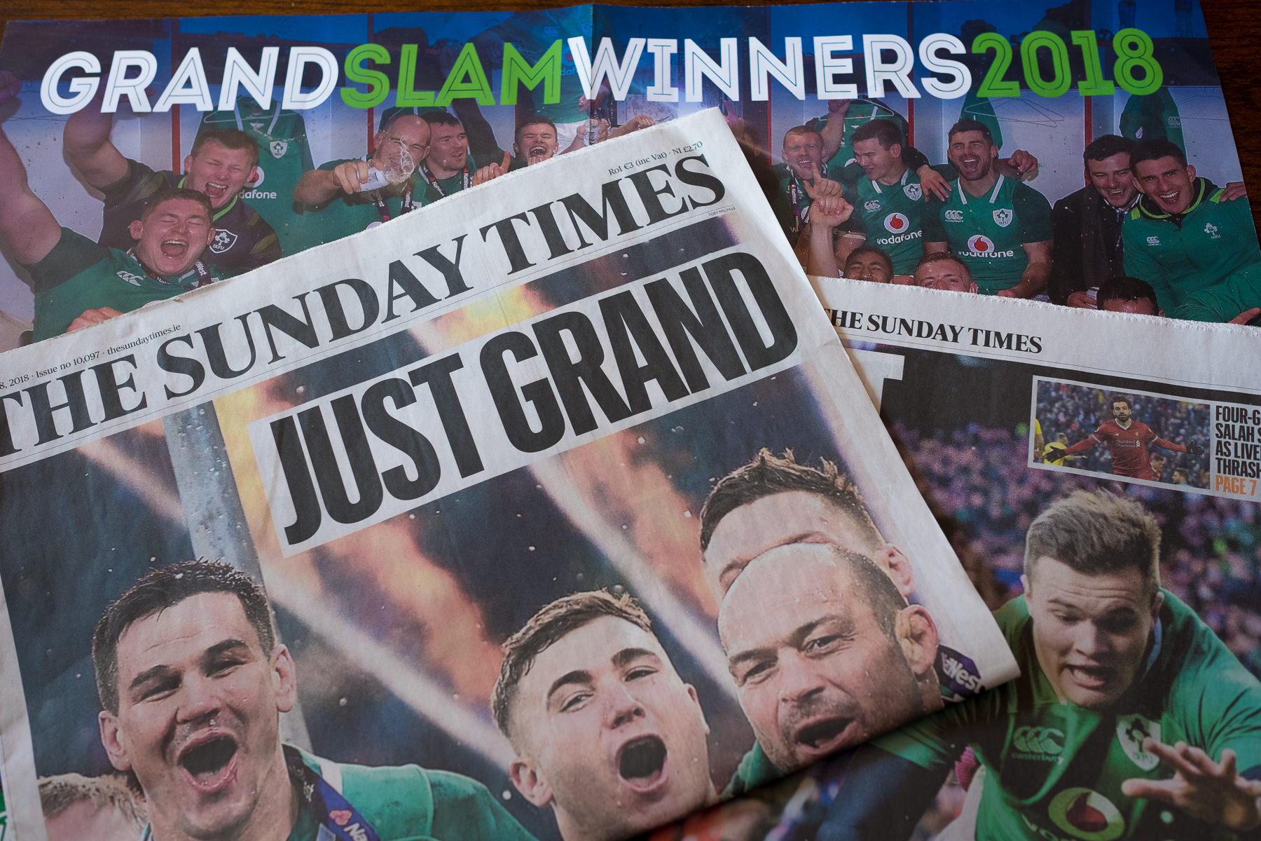 Irish newspaper front page with photograph of celebrating Irish rugby team.