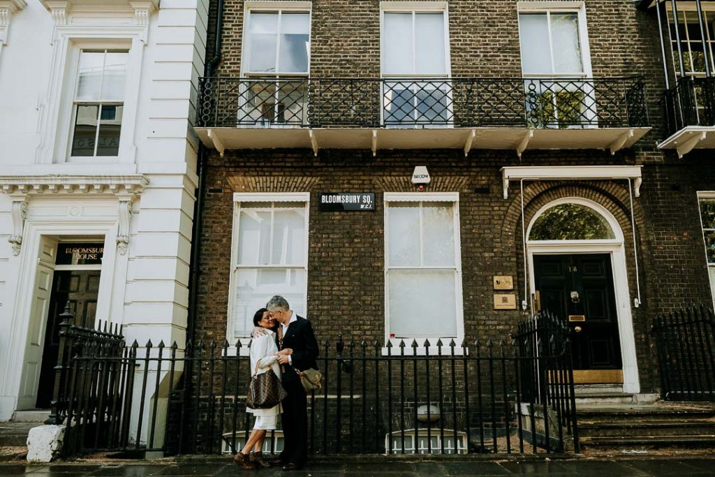London couple embrace in Bloomsbury Square London