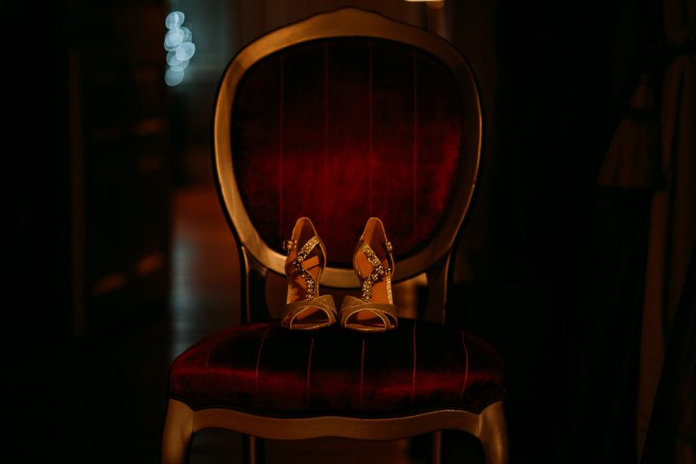 carton house wedding shoes on red velvet chair