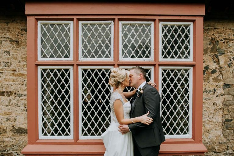 Carton House wedding couple kiss outside Shell cottage Maynooth
