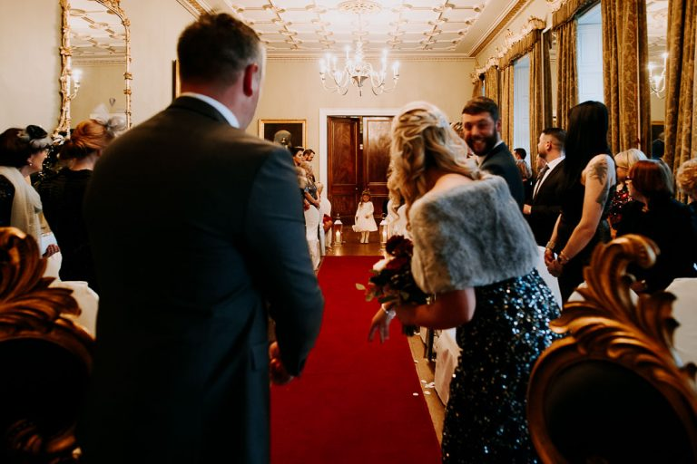 Carton House wedding ceremony child throwing confetti as she walks towards her dad on his wedding day