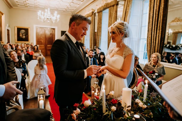 carton house wedding couple exchange rings during wedding ceremony