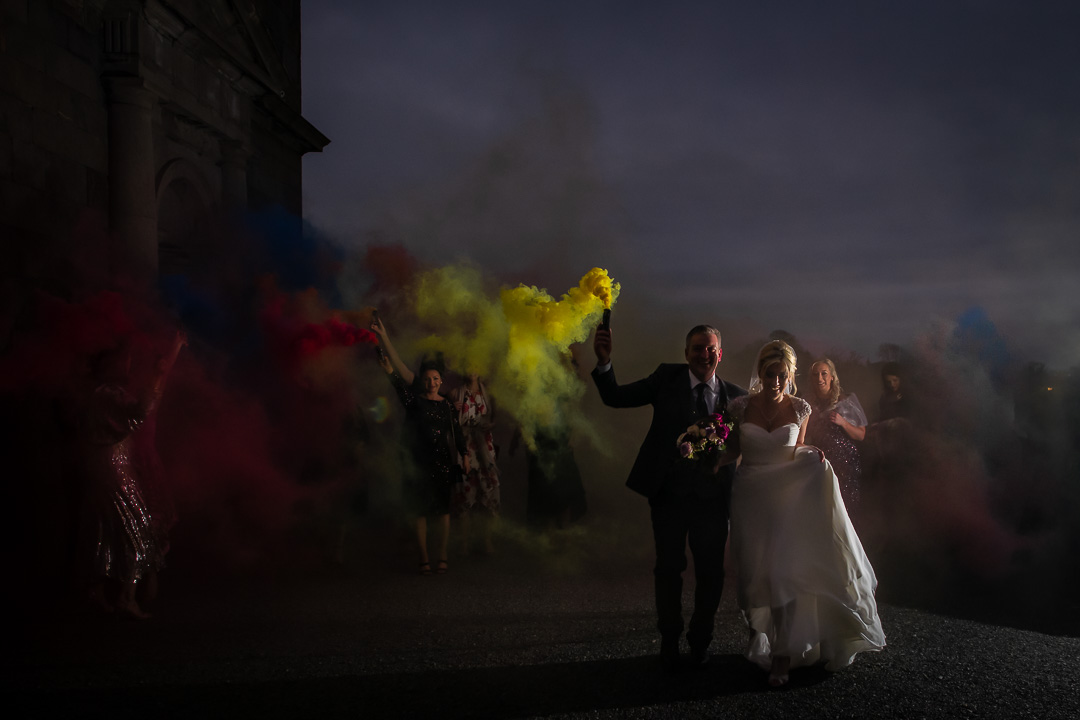 Carton House wedding couple and guests run with coloured flares