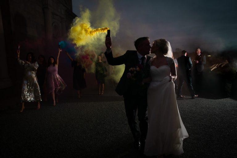 Carton House wedding couple run with smoke flares