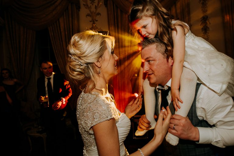 Carton House wedding bride and groom and daughter celebrate at end of evening