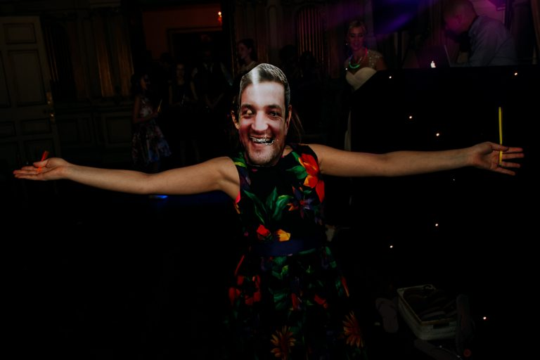 carton house wedding child wears mask of groom whilst dancing