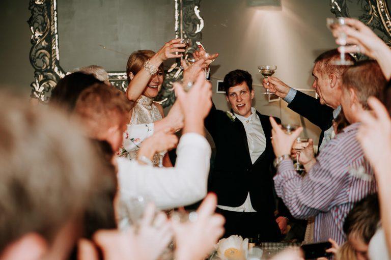 newly married same-sex couple wedding toast Dead Dolls house