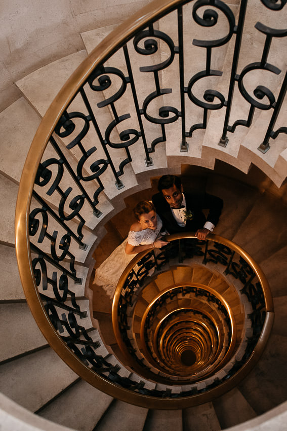 The Ned Hotel staircase with newly married couple London candid wedding photography
