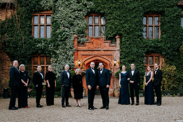 wedding party in front of woodhall manor wedding venue