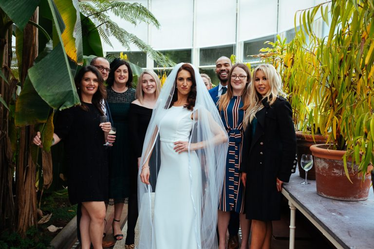Bride strikes a pose with friends in the Orangery at Kilshane House